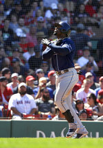 Tampa Bay Rays' Yandy Diaz celebrates as he arrives at home after hitting a home run in the seventh inning of a baseball game against the Boston Red Sox, Sunday, June 9, 2019, in Boston. (AP Photo/Steven Senne)