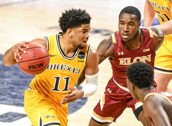 Drexel guard Camren Wynter (11) drives against Elon guard Ikenna Ndugba (11) during the first half of the Colonial Athletic Association Championship game at James Madison University in Harrisonburg, Va., Tuesday, March 9, 2021. (AP Photo/Daniel Lin)