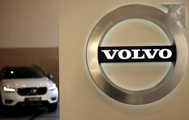 A Volvo car is parked behind the Volvo logo in the lobby of the Volvo corporate headquarters, prior to a media conference on the 2019 Full Year Financial Results, in Brussels, Thursday, Feb. 6, 2020. (AP Photo/Virginia Mayo)