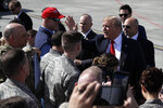 President Donald Trump greets troops after landing at Joint Base Elmendorf-Richardson for a refueling stop en route to Japan Friday, May 24, 2019, in Anchorage. (AP Photo/Evan Vucci)