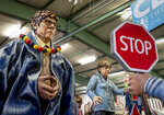 Figures depicting German Chancellor Angela Merkel, right, and CDU leader Annegret Krampp-Karrenbauer are shown during a press preview for the Mainz carnival, in Mainz, Germany, Tuesday, Feb. 18, 2020. (AP Photo/Michael Probst)