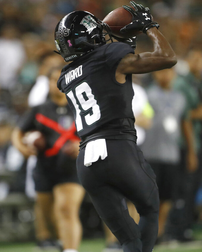 Hawaii wide receiver JoJo Ward (19) makes a catch over Nevada during the third quarter at an NCAA college football game Saturday, Oct. 20, 2018, in Honolulu. (AP Photo/Marco Garcia)