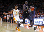 Alabama State guard Leon Daniels (1) catches an inbound pass as he's defended by Tennessee guard Josiah-Jordan James (5) during the first half of an NCAA college basketball game Wednesday, Nov. 20, 2019, in Knoxville, Tenn. (AP Photo/Wade Payne)