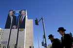 FILE - In this Feb. 4, 2019, file photo, an election campaign billboard shows Israeli Prime Minister Benjamin Netanyahu, right, and U.S. President Donald Trump in Jerusalem. Hebrew on the billboard reads: