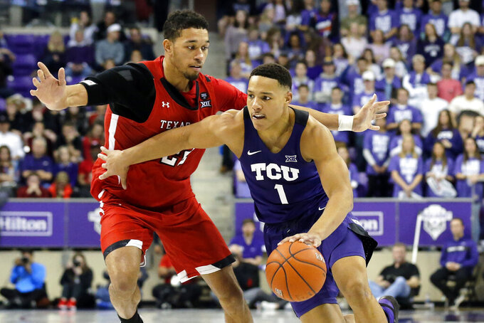FILE - TCU guard Desmond Bane, right, drives to the basket as Texas Tech forward TJ Holyfield, left, defends during the second half of an NCAA college basketball game in Fort Worth, Texas, in this Tuesday, Jan. 21, 2020, file photo. Bane is a possible pick in the NBA Draft, Wednesday, Nov. 18, 2020. (AP Photo/Ray Carlin, File)