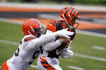 Cincinnati Bengals quarterback Joe Burrow, right, is sacked by Cleveland Browns' Myles Garrett (95) during the first half of an NFL football game, Sunday, Oct. 25, 2020, in Cincinnati. (AP Photo/Michael Conroy)