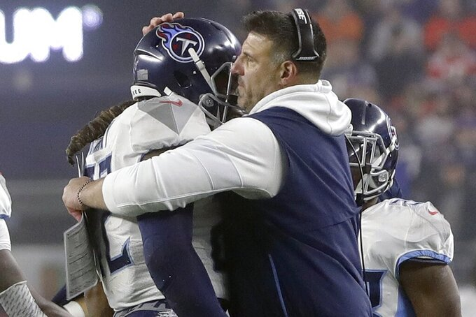 Tennessee Titans head coach Mike Vrabel, right, congratulates running back Derrick Henry after his touchdown dive in the first half of an NFL wild-card playoff football game against the New England Patriots, Saturday, Jan. 4, 2020, in Foxborough, Mass. (AP Photo/Steven Senne)