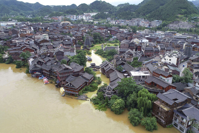 An aerial view shows the ancient town of Xiasi during flooding in Kaili city in southwest China's Guizhou province, Tuesday, June 23, 2020. Flooding and mudslides in southern China have killed some and forced evacuations for thousands of people, official media reported Tuesday. (Chinatopix via AP)
