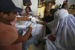 A Pakistani doctor screens villagers for HIV at a hospital in a village near Ratodero, a small town in southern province of Sindh in Pakistan where the outbreak of deadly disease took place last month, Thursday, May 16, 2019. Officials say about 500 people, mostly children, have tested positive for HIV, the virus that causes AIDS, in a southern Pakistani provincial district. A local doctor who has AIDS has since been arrested and is being investigated for possibly intentionally infecting patients. (AP Photo/Fareed Khan)