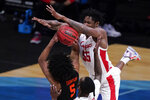 Houston forward Brison Gresham (55) defends Oregon State guard Ethan Thompson (5) during the first half of an Elite 8 game in the NCAA men's college basketball tournament at Lucas Oil Stadium, Monday, March 29, 2021, in Indianapolis. (AP Photo/Michael Conroy)