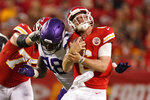 Kansas City Chiefs quarterback Shane Buechele, right, is hit by Minnesota Vikings defensive end D.J. Wonnum (98) during the first half of an NFL football game Friday, Aug. 27, 2021, in Kansas City, Mo. (AP Photo/Charlie Riedel)