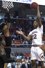 Auburn guard Allen Flanigan (22) scores against Georgia during the first half of an NCAA college basketball game Saturday, Jan. 11 2020, in Auburn, Ala. (AP Photo/Julie Bennett)