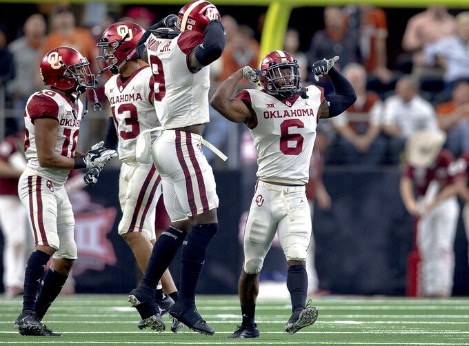 Oklahoma cornerback Tre Brown (6) celebrates his safety during the Big 12 Conference championship NCAA college football game against Texas in Arlington, Texas, on Saturday, Dec. 1, 2018.  (Nick Wagner/Austin American-Statesman via AP)