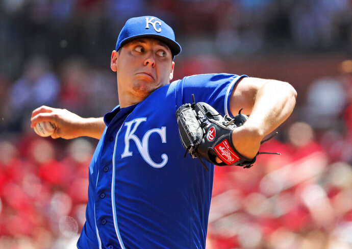 Kansas City Royals starting pitcher Brad Keller throws during the first inning in the first game of a baseball doubleheader against the St. Louis Cardinals Wednesday, May 22, 2019, in St. Louis. (AP Photo/Jeff Roberson)