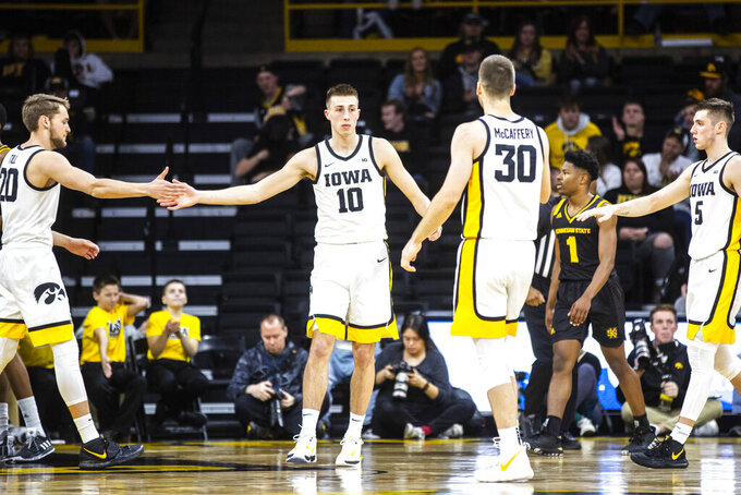 Iowa guard Joe Wieskamp (10) gets congratulations from teammates Riley Till, left, Connor McCaffery (30) and C.J. Frederick (5) after drawing a foul during an NCAA college college basketball game against Kennesaw State, Sunday, Dec. 29, 2019, in Iowa City, Iowa. (Joseph Cress/Iowa City Press-Citizen via AP)