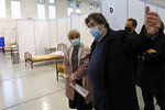 Portuguese Health Minister Marta Temido, centre, visits a new field hospital set up in a sports hall in Lisbon, Wednesday, Jan. 20, 2021.