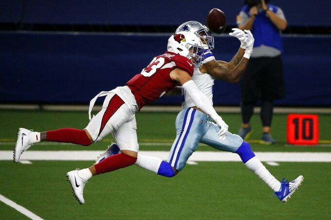 Arizona Cardinals cornerback Byron Murphy Jr. (33) breaks up a pass attempt intended for Dallas Cowboys' Cedrick Wilson (11) in the second half of an NFL football game in Arlington, Texas, Monday, Oct. 19, 2020. (AP Photo/Michael Ainsworth)