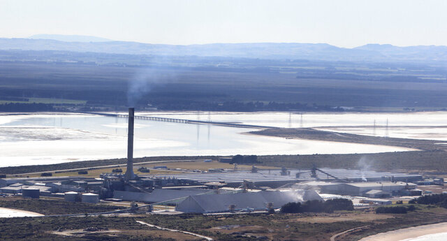 An aerial photo shows Tiwai Point aluminum smelter near Invercargill, New Zealand, March 30, 2013. Mining giant Rio Tinto said Thursday, July 9, 2020, it will close its aluminum smelter in southern New Zealand, resulting in 1,000 job losses and dealing a major economic blow to the region (Grant Bradley/NZ Herald via AP)