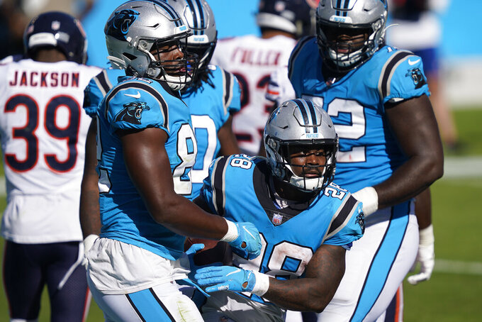 Carolina Panthers running back Mike Davis (28) and tight end Chris Manhertz, left, celebrate Davis' touchdown against the Chicago Bears during the second half of an NFL football game in Charlotte, N.C., Sunday, Oct. 18, 2020. (AP Photo/Brian Blanco)