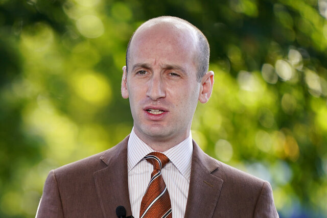 FILE - In this Aug. 20, 2020, file photo President Donald Trump's White House Senior Adviser Stephen Miller speaks during a television interview outside the White House in Washington. One of President Donald Trump's top immigration priorities in a second term would be to use agreements with Central American governments as models to get countries around the world to field asylum claims from people seeking refuge in the United States, Miller said Friday, Oct. 23. (AP Photo/Patrick Semansky, File)