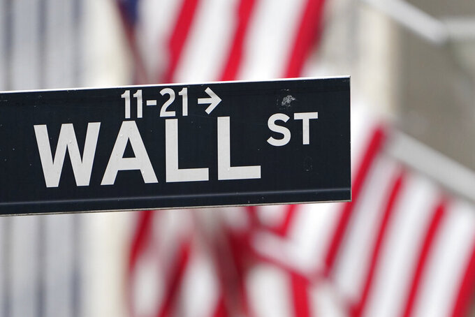 FILE - In this Nov. 23, 2020 file photo, a street sign is displayed at the New York Stock Exchange in New York. Stocks were mixed in early trading on Monday, March 15, 2021,  as investors sifted a mixed bag of data from China. Wall Street continues to eye the bond market, where yields gave back some of last week's gains.  (AP Photo/Seth Wenig, File)