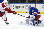 New York Rangers goaltender Henrik Lundqvist (30) makes the save against Detroit Red Wings center Andreas Athanasiou (72) during the first period of an NHL hockey game, Wednesday, Nov. 6, 2019, at Madison Square Garden in New York. (AP Photo/Mary Altaffer)