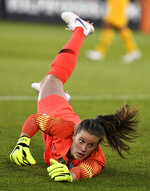 FILE - In this July 29, 2018, file photo, U.S. goalkeeper Alyssa Naeher dives for a shot on goal that went wide during a women's international soccer match against Australia, in East Hartford, Conn. Naeher recalls that as a freshman in college a teammate told her she couldn't afford to be intimidated. The U.S. national team goalkeeper carries that advice as she prepares for the World Cup. (AP Photo/Jessica Hill, File)