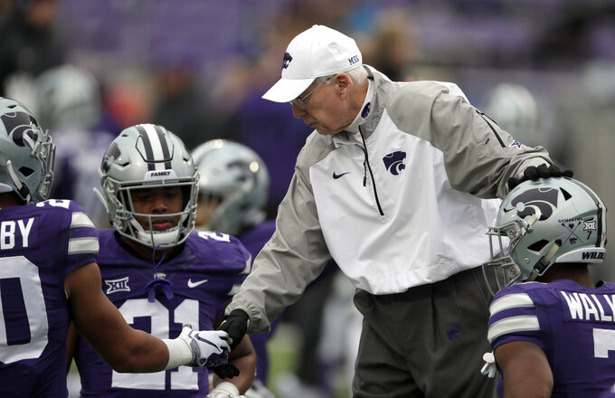 Kansas State head coach Bill Snyder greets players Denzel Goolsby, left, and Eli Walker, right, before an NCAA college football game against Texas Tech in Manhattan, Kan., Saturday, Nov. 17, 2018. (AP Photo/Orlin Wagner)