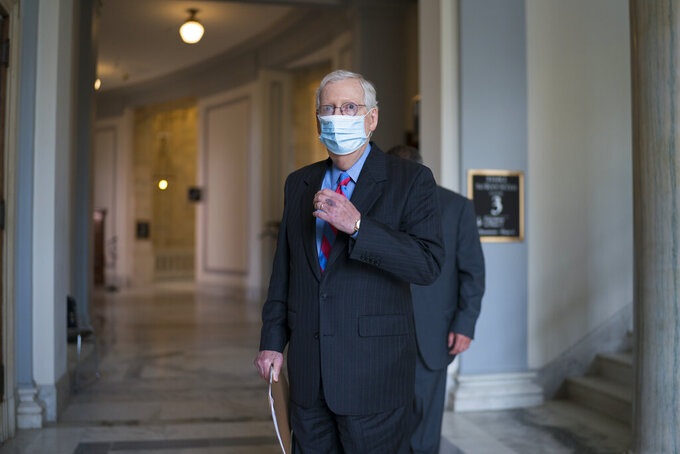 Senate Minority Leader Mitch McConnell, R-Ky., leaves a meeting with fellow Republicans on Capitol Hill in Washington, Thursday, April 29, 2021, the day after President Joe Biden addressed Congress on his first 100 days in office. (AP Photo/J. Scott Applewhite)