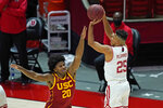 Utah guard Alfonso Plummer (25) shoots as Southern California guard Ethan Anderson (20) defends during the second half of an NCAA college basketball game Saturday, Feb. 27, 2021, in Salt Lake City. (AP Photo/Rick Bowmer)