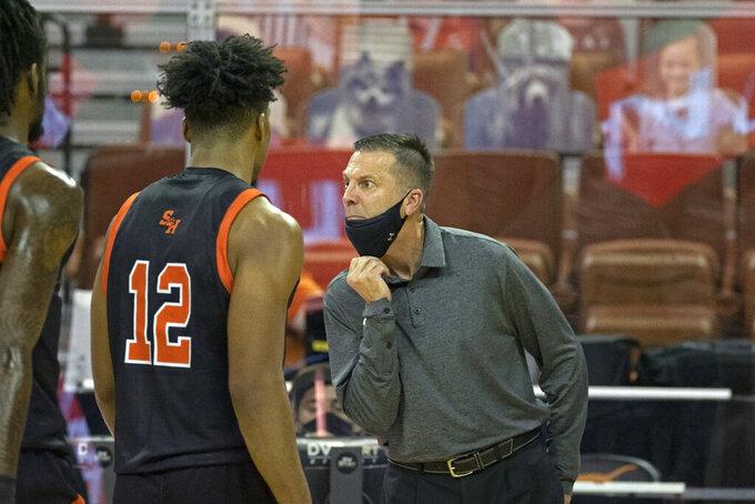 Sam Houston State head coach Jason Hooten shows his displeasure with his team during the second half of an NCAA college basketball game against Texas, Wednesday, Dec. 16, 2020, in Austin, Texas. Texas won 79-63. (AP Photo/Michael Thomas)