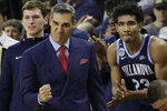 Villanova head coach Jay Wright and forward Jermaine Samuels (23) celebrate from the bench in the last seconds of an NCAA college basketball game against Providence, Saturday, Jan. 25, 2020, in Providence, R.I. Villanova won, 64-60. (AP Photo/Elise Amendola)