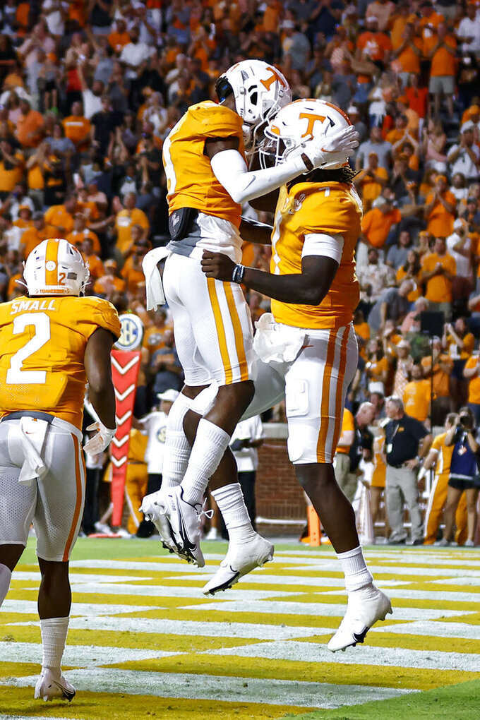 Tennessee quarterback Joe Milton III (7) celebrates a touchdown against Bowling Green with wide receiver JaVonta Payton (3) during the first half of an NCAA college football game Thursday, Sept. 2, 2021, in Knoxville, Tenn. (AP Photo/Wade Payne)