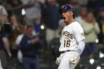 Milwaukee Brewers' Kolten Wong reacts after hitting a solo home run during the first inning of a baseball game against the New York Mets Friday, Sept. 24, 2021, in Milwaukee. (AP Photo/Aaron Gash)