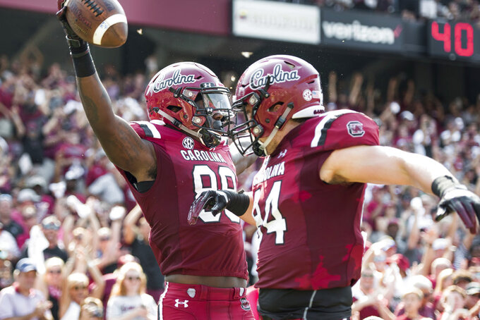South Carolina wide receiver Bryan Edwards (89) and Kyle Markway (84) celebrate a touchdown during the first half of an NCAA college football game against Missouri, Saturday, Oct. 6, 2018, in Columbia, S.C. (AP Photo/Sean Rayford)