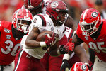 South Carolina running back Rico Dowdle (5) avoids a tackle from Georgia inside linebacker Tae Crowder (30) and Georgia defensive lineman Devonte Wyatt (95) in overtime of a NCAA football game between Georgia and South Carolina in Athens, Ga., on Saturday, Oct. 12, 2019. South Carolina won 20-17 in double overtime. (Joshua L. Jones/Athens Banner-Herald via AP)