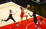 Las Vegas Aces' Dearica Hamby, center, drives to the basket between Seattle Storm's Katie Lou Samuelson, left, and Ezi Magbegor during the second quarter of a WNBA basketball game at Michelob Ultra Arena on Sunday, June 27, 2021, in Las Vegas. (Chase Stevens/Las Vegas Review-Journal via AP)