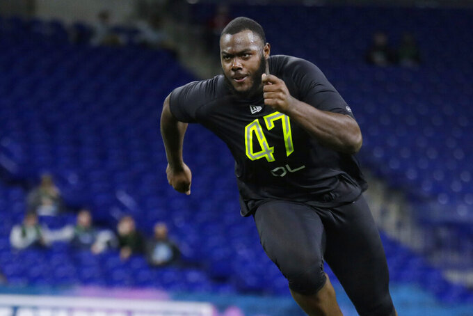FILE - In this Feb. 28, 2020, file photo, Georgia offensive lineman Andrew Thomas runs a drill at the NFL football scouting combine in Indianapolis. The Giants drafted tackle Andrew Thomas of Georgia with the fourth pick overall in the recent draft. He probably will replace Nate Solder, who opted out of the 2020 NFL season because of the coronavirus pandemic. (AP Photo/Michael Conroy, File)