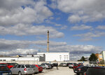 Man walks at the parking lot of the PBS factory in in Velka Bites, Czech Republic, Thursday, Sept. 19, 2019. Small engines built by Czech firm PBS Aerospace are believed to have been used in an attack last weekend that targeted the heart of Saudi Arabia's oil industry. (AP Photo/Petr David Josek)