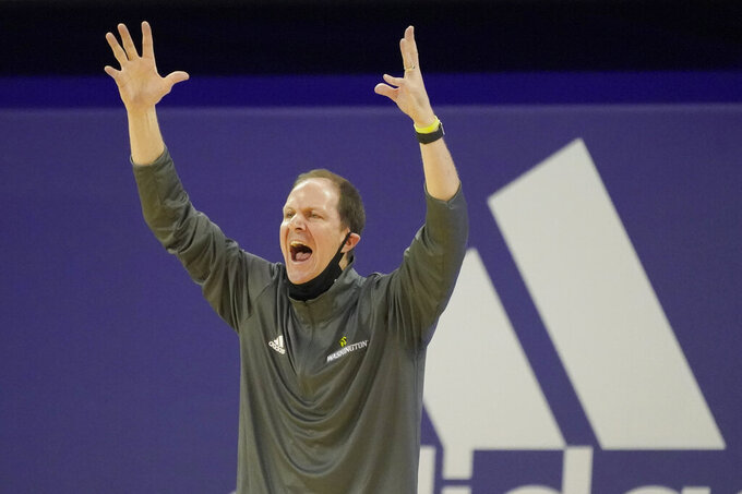 Washington head coach Mike Hopkins reacts near the bench during the first half of an NCAA college basketball game against Utah, Sunday, Jan. 24, 2021, in Seattle. (AP Photo/Ted S. Warren)