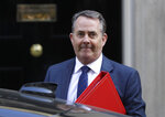 Liam Fox Britain's Secretary of State for International Trade arrives for a Cabinet meeting at Downing Street in London, Monday, March 25, 2019. Embattled Prime Minister Theresa May was scrambling Sunday to win over adversaries to her Brexit withdrawal plan as key Cabinet ministers denied media reports that they were plotting to oust her. (AP Photo/Kirsty Wigglesworth)