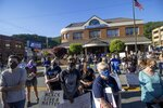 In this June 12, 2020, photo provided by Oakley Fugate, demonstrators attend a Black Lives Matter rally in Whitesburg, Ky., June 12, 2020. Following the deaths of George Floyd in Minneapolis and Breonna Taylor in Louisville, Dayja Hogg helped organize a protest in her home town of Whitesburg where she grew up experiencing racism. (Oakley Fugate via AP)
