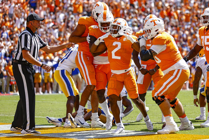 Tennessee running back Jabari Small (2) celebrates a touchdown with teammates during the first half of an NCAA college football game against Pittsburgh, Saturday, Sept. 11, 2021, in Knoxville, Tenn. (AP Photo/Wade Payne)