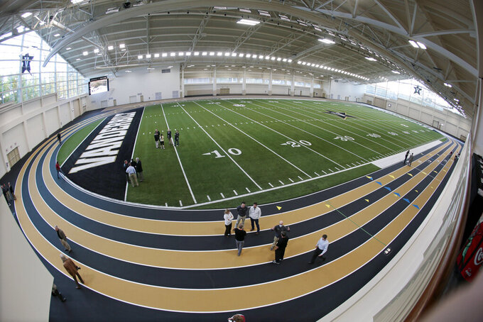 FILE — In this Nov. 5, 2013, file photo made with a fisheye lens, people view Vanderbilt's new multipurpose facility field house in Nashville, Tenn. Vanderbilt announced a $300 million project Monday, March 29, 2021, to improve football and basketball facilities and a new Vandy United Fund to raise money for athletics programs. (AP Photo/Mark Humphrey, File)