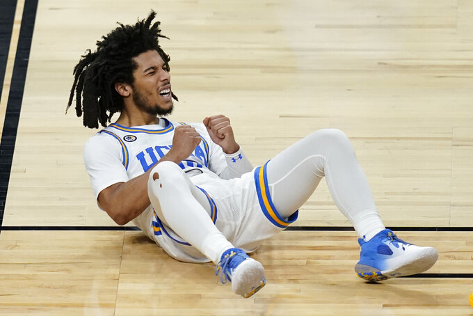 UCLA's Tyger Campbell (10) reacts after a play against Oregon State during the second half of an NCAA college basketball game in the quarterfinal round of the Pac-12 men's tournament Thursday, March 11, 2021, in Las Vegas. (AP Photo/John Locher)