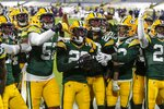 Green Bay Packers' Darnell Savage (26) celebrates his interception with teammates during the first half of an NFL football game Sunday, Nov. 29, 2020, in Green Bay, Wis. (AP Photo/Matt Ludtke)