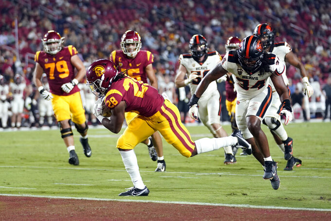 Southern California running back Keaontay Ingram (28) scores past Oregon State linebacker Avery Roberts (34) during the first half of an NCAA college football game Saturday, Sept. 25, 2021, in Los Angeles. (AP Photo/Marcio Jose Sanchez)