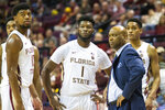 Florida State head coach Leonard Hamilton, forwards RaiQuan Gray (1) and Malik Osborne (10) watch in the second half of an NCAA college basketball game against Georgia Tech in Tallahassee, Fla., Tuesday, Dec. 31, 2019. (AP Photo/Mark Wallheiser)