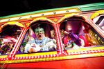 Float riders encourage the crowd as the Krewe of Orpheus rolls in New Orleans, Monday, Feb. 12, 2018. (AP Photo/Gerald Herbert)