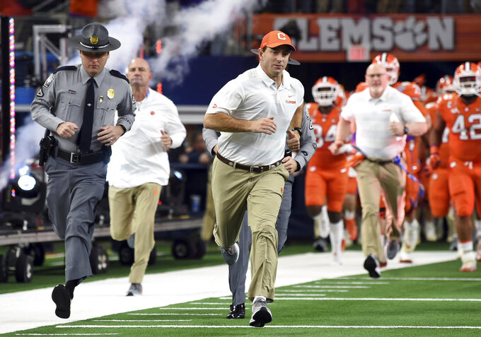 Clemson head coach Dabo Swinney jogs onto the field for the first half of the NCAA Cotton Bowl semi-final playoff football game against Notre Dame on Saturday, Dec. 29, 2018, in Arlington, Texas. (AP Photo/Jeffrey McWhorter)